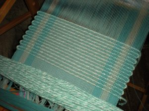 Wind Rug Filler on one shuttle and Rug Warp on a 2nd shuttle to alternate these yarns when weaving.